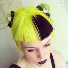 Manic Panic Electric Banana hair dye adds some major attitude to her look. Also the eyeball hairbows!