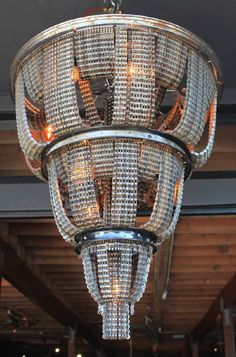Elegant chandeliers Made From Reclaimed Bicycle Chains by artist Carolina Fontoura Alzaga. Tire Furniture, Recycled Furniture, Home Decor Furniture, Furniture Ideas, Recycled Bike Parts, Bicycle Parts, Recycled Tires, Recycled Art, Cool Lighting