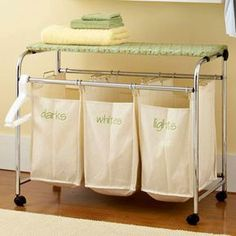 Dual-Purpose Laundry Cart- this is a great idea for the small space I live in! Separate laundry in a multibag rolling hamper and speed up wash day. Get even more out of the hamper by topping it with a flip top folding board or padded ironing board