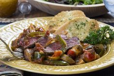Tihis is a company-fancy recipe for the ages! This simple recipe features steak simmered with flavorful onions, peppers, tomatoes, and easy seasonings.