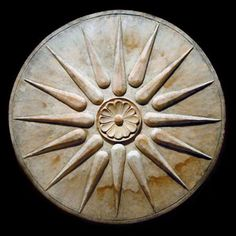 This 16-rayed star is the national Macedonian royal symbol of Philip of Macedon, Alexander the Great, and the ancient Macedonian Empire. This ancient Macedonian symbol is also know as the Macedonian Star, Macedonian Sun, Sun of Vergina, and Star of Vergina, after the location of the Macedonian royal tombs.