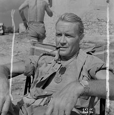 John Mills relaxes on the set of Ice Cold in Alex