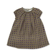 Made from soft wool, this A-line dress features a cool sixties-inspired print, a pleated front and elasticated sleeves. Fully lined with an invisible back zip.<br>Available in sizes 6M-24M</br>