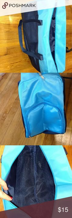 "NWOT Yoga/gym bag Two tone blue bag with zip top closure, inside zip side pocket and mesh to separate top and bottom layers. Side zip panel with ""tunnel"" for easy yoga mat, sneaker etc storage and access. dsw Bags"