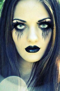 Make-up. Black feather eyelashes. Liquid eyeliner pen for detail, maybe gel eyeliner under eyes and use eyeshadow or smudge to get black under