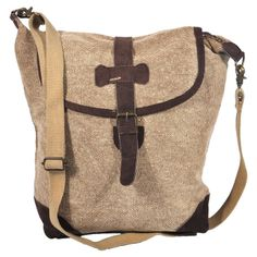 Canvas and leather crossbody satchel with an adjustable strap. Product: Satchel Construction Material: Cotton and leatherColor: BrownFeatures: Zippered closure LinedMagnetically fastened flap Dimensions: H x W x D Cute Handbags, Purses And Handbags, Expensive Handbags, Book Purse, Michael Kors Satchel, Vogue, Brown Bags, Swagg, Clutch Wallet