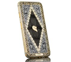 If Tyrion Lannister had a smartphone (or even knew they existed), we imagine he would have the Momentum from Finland-based Legend. The customized iPhone features the company's lion logo (which happens to be perfect for a Lannister) in Iphone 6s Features, Hand Engraving, Apple Iphone 6, Smartphone, Antiques, Gold, Diamond, Luxury Lifestyle, Bespoke