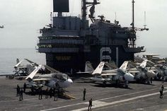 In this 1980 Navy photo an EA-6B Prowler and three A-6E Intruders aircraft are lined up on the flight deck of the aircraft carrier USS Ranger (CV-61).