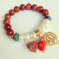 Prety bracelet (by Luz Marina Valero?) Link only goes to larger pic. Love the charms & tiny tassel!