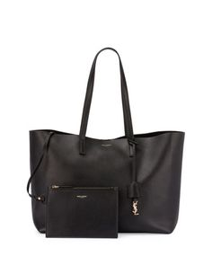 Large+East-West+Leather+Shopper+Bag,+Black+by+Saint+Laurent+at+Neiman+Marcus. I'll take the burgundy please