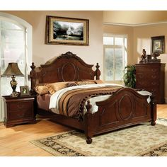 A baroque style platform bed is the heart of this bedroom set. The bed's intricate carvings and rich solid wood frame create a luxurious traditional style, echoed by the matching case goods.