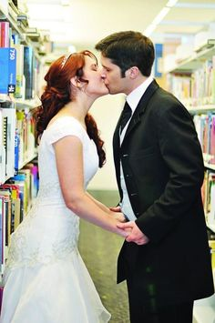 Bride and groom photos in the public library to reflect the couple's love of books and learning.