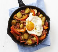 Spanish eggs with chorizo & peppers. We think Heck Smoky Chorizo Style sausages are perfect for this BBC Good Food recipe!