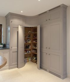 Corner pantry with convex curved doors - grey kitchen cabinets - Bespoke Interiors. Not so much the curved idea but a corner pantry. Kitchen Corner Cupboard, Pantry Cupboard, Kitchen Cabinet Storage, Grey Kitchen Cabinets, Storage Cabinets, Pantry Doors, Corner Cabinets, Wall Cabinets, Pantry Storage