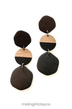 Black polymer clay earrings. Organic circle shaped earrings with wood and resin connectors. Unique boho style earrings make the perfect accessory for a fall work outfit. Give as a unique birthday gift for daughter, best friend, or coworker. Makes a great fall birthday gift! Shop these trendy handmade earrings for women in my etsy shop!