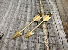 Shiny brass arrow earrings with vintage pyramid studs! Give these beauties at 15% off - code GIVECHEER15 Valid through 12/16/14