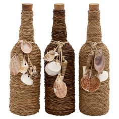 Dressed in twine and draped in seashells, this bottle decor adds a breeze of coastal appeal atop your home bar or foyer console table.