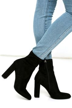 """Give your ensemble an instant update with the Steve Madden Edit Black Suede High Heel Mid-Calf Boots! Every it-girl will want these vegan suede booties with an almond toe, and a 7"""" fitted shaft (with a bit of stretch). Zipper at instep."""
