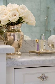 fresh flowers in your bathroom are a must for clean fresh look that feels like a hotel room bathroom :) love the marble and gold tones