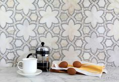 Reina, a natural stone waterjet mosaic shown in Cloud Nine and Ming Green polished marbles, is part of the Miraflores Collection by Paul Schatz for New Ravenna Mosaics.  Copyright New Ravenna Mosaics 2013