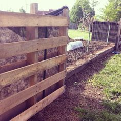 Putting the fence up around the garden ... to keep the pups out.  The corners are living pallet walls that we will fill with dirt and plant.
