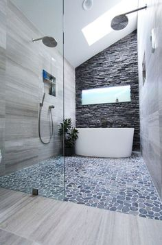 wow... slate bathtub wall + pebbled floor + rainfall shower heads ~ http://walkinshowers.org/6-incredible-rainfall-shower-head-examples.html