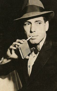 Humphrey Bogart-- Okay, this picture is neither funny nor random, however, each time I scroll past it I think he's holding a juice box. Now that is random! :-)