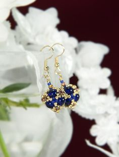 Cobalt, Rainbow Topaz, Gold Mariposa Lily earrings by InetasJewelry on Etsy