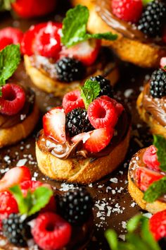 Nutella Berry Crostini - Grilled crostini slathered with chocolate hazelnut spread and topped with summer's finest Berries.