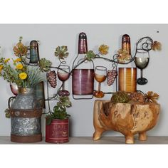 This wall art features wine bottles, stemwares and grapevine sculptures ideal for countryside kitchens and dining areas. It is made of iron with a multicolored finish that will add life and vibrancy to your wall. The open design of this wall art make Wine Wall Decor, Country Wall Decor, Metal Wall Decor, Metal Wall Art, Mediterranean Wall Decor, Countryside Kitchen, Grape Kitchen Decor, Wine Bottle Design, Vine Wall