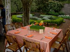Square table with bamboo chairs add personality to the lovely gardens at Lakewold. Snuffin's Catering | Gig Harbor | Tacoma | Wedding