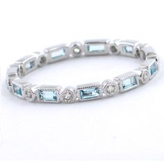 Stackable Round Diamond & Baguette Blue Topaz Ring - love love love this as eternity ring but instead of round have diamond shape maybe even in purple but also in yellow gold Leaf Engagement Ring, Eternity Ring Diamond, Eternity Bands, Anniversary Jewelry, Right Hand Rings, Blue Topaz Ring, White Gold Rings, Blue Rings, Bracelets
