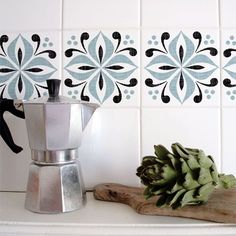 """Mibo Tile Tattoos: Cover up an ugly backsplash with these waterproof peel-and-stick decals designed for standard tiles. Shown: 4"""" Mibo Ventor Tiles in Blue, Set of 6, $18 at 2Jane."""