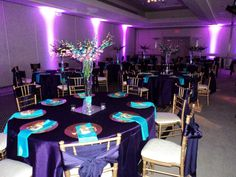 We've done teal and purple before with white but black is lovely too. Notice that uplighting ties it all together. Adrian Events owns 20 full spectrum LED wireless lights just like these!