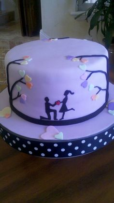 """Engagement Cake - Three Layer 9"""" round carrot cake with fondant details."""
