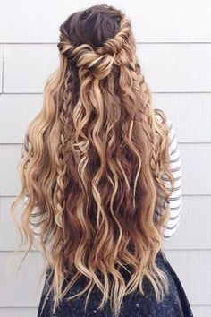 twisted braided hairstyle on brunette hair with blonde highlights