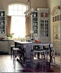 tall cabinets   vaulted ceilings  gray green cabs  center island