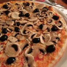 Pizza funghi with mushrooms and black olives.
