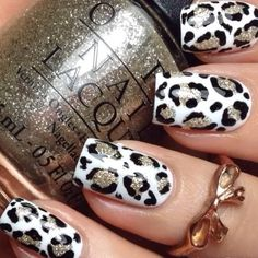 White nails with a black and gold cheetah print