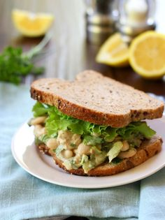 Smashed Bean Tahini Caesar Salad Sandwich   Some uncommon ingredients but it sounds like it would be worth it!