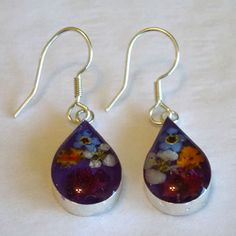 Real Flower Earrings, Purple Teardrop. The flowers are real flowers grown without fertilizers or pesticides. Earrings are made through cottage industry in Taxco Mexico.  Margarito Santos and his brother started the business and with a small team of workers they grow the flowers and make the jewelry in their homes, encasing and preserving the flowers. Fair Trade!