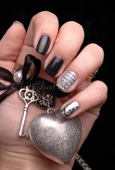 """Three nails have 2 coats of Cult Nails """"Blackout,"""" the ring finger 2 coats of Essence """"Got A Secret"""" stamped with plate BM-311, then the pinky has 1 coat Sally Hansen """"Celeb City"""" + 1 coat Sephora by OPI """"Flurry Up!"""" 
