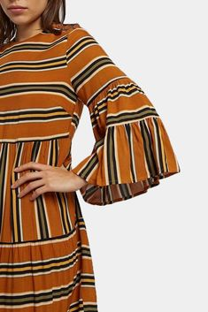 Make a statement in the Theana Ochre Stripe trapeze Dress by designed in the UK by British brand Louche. Theana has gorgeous mustard coloured alternating stripes, a loose trapeze shape and delicate wooden buttons to the shoulder. Striped Midi Dress, Online Dress Shopping, Boutique Dresses, Dresses Online, Outfit Of The Day, Bell Sleeve Top, Stripes, Mustard, Delicate