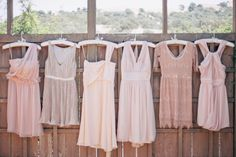 mismatched nude/blush dresses. love this color idea for whole wedding