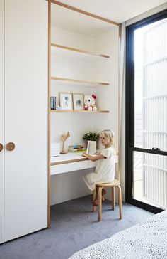 A Sleek, Two-Story Addition Hides Behind a Traditional Cottage in Sydney - Photo. A Sleek, Two-Story Addition Hides Behind a Traditional Cottage in Sydney - Photo 11 of 12 - Bedroom Desk, Bedroom Cupboards, Bedroom Wardrobe, Bed Room, Bedroom Toys, Wood Bedroom, Wardrobe Behind Bed, Girls Bedroom Storage, Girls Wardrobe