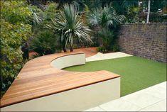 Backyard seating in garden brick wall