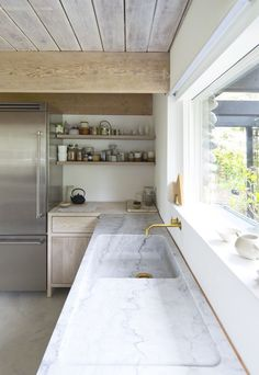 that marble worktop and integrated sink is beautiful. dream kitchen sink run