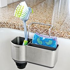 Tidy up the sink area with this stainless steel caddy. Tucked in this over-sink caddy, sponges and brushes stay handy without cluttering the countertop. And with plenty of drainage and air circulation, they stay fresher longer, too. $18.98