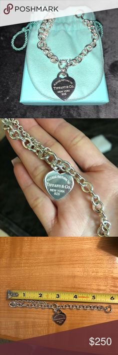 "Tiffany & co. Heart Tag Bracelet Great condition! Sterling Silver Double chain link I adjusted this bracelet to my wrist size about 5 3/4""  Comes with additional links that were removed so you can take to any Tiffany location and you can adjust to your wrist size Comes with storage pouch and box 100% authentic Tiffany & Co. Jewelry Bracelets"