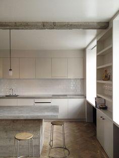 Concrete counters, narrow shelves for glasses